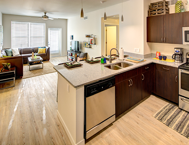 Fully equipped kitchen with view overlooking the spacious living area at 2125 Franklin