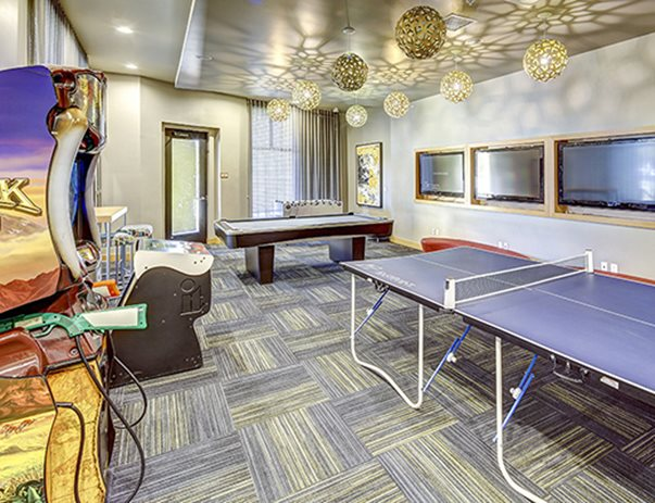 Recreation center with billiards, foosball, ping pong, Golden Tee® & Big Buck Hunter® arcade games at Casas del Rio