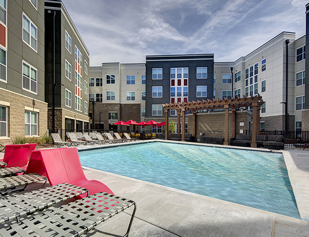 View of the swimming pool with sun deck at University Pointe