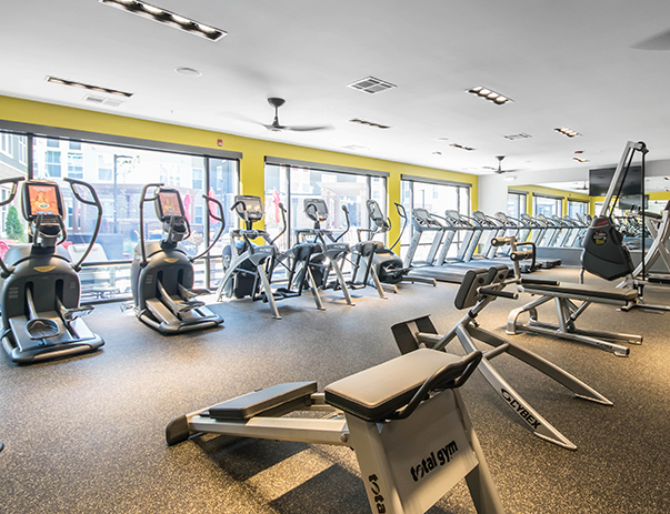 24-hour fitness center with strength equipment, cardio machines & free weights