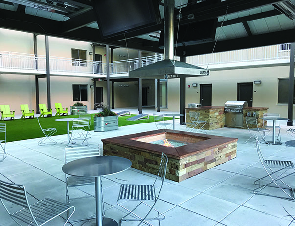 New heated courtyard pavilion with fire pit, TVs & multiple lounge areas