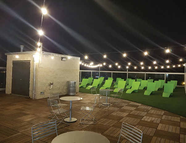 Renovated rooftop terrace with new seating and lounge chairs