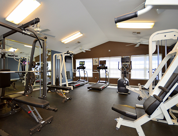 Fitness center at College Club Townhomes