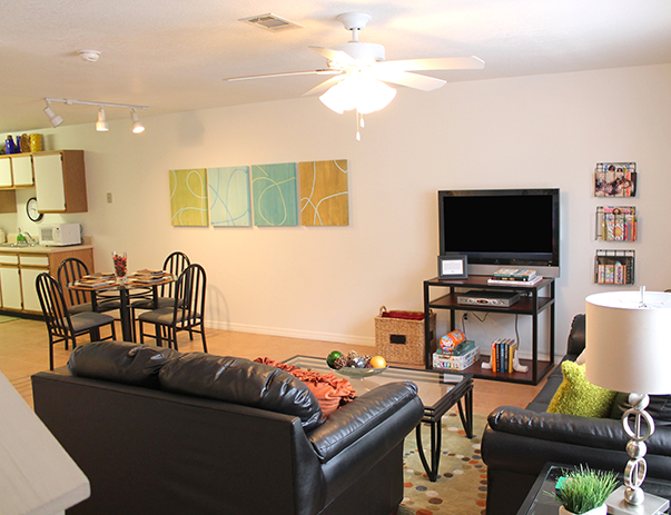 Fully furnished, spacious living room at College Club Townhomes