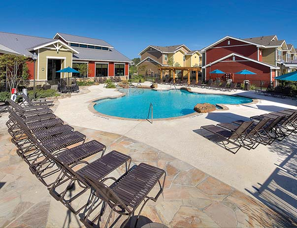 Swimming pool and sundeck at U Club Townhomes on Marion Pugh