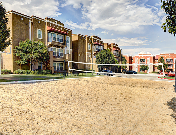 Sand volleyball court at Uptown Apartments in Denton, TX near the University of North Texas