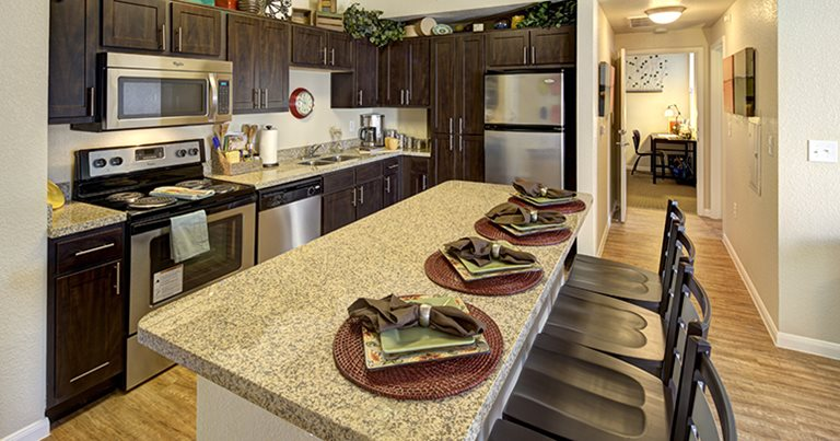 Fully equipped kitchen at Campus Edge on UTA Boulevard near The University of Texas at Arlington in Arlington, TX