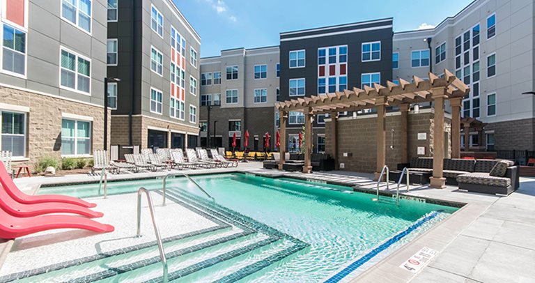 Swimming pool and sundeck at University Pointe
