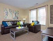 Fully furnished, spacious living room at Cardinal Towne