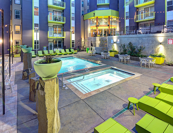The resort-style swimming pool is complete with a hot tub, sun deck, poolside fire pit & professional BBQ grills at 2125 Franklin