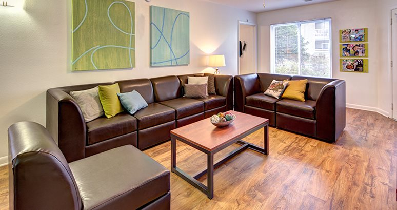 ... Fully Furnished Living Room With Leather Style Sectional Sofa ...