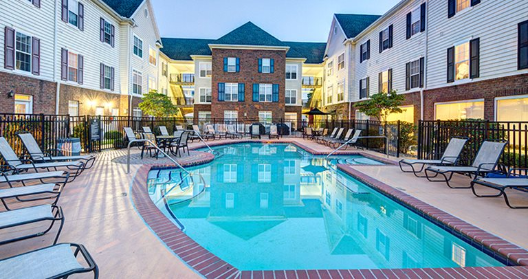 Swimming pool and sundeck at Olde Towne University Square