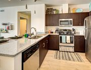 Fully equipped kitchens with granite countertops & stainless steel appliances at 2125 Franklin