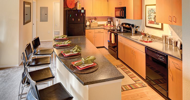 Fully equipped kitchen at 2nd Ave Center in Gainesville, FL near The University of Florida