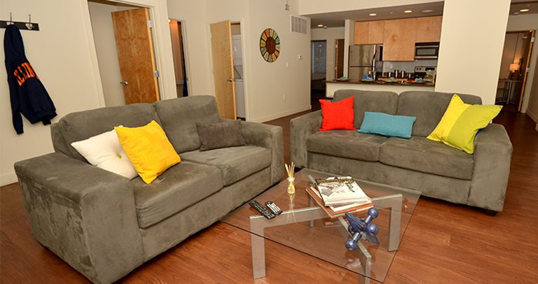 Fully furnished spacious living room at Lofts54 near the University of Illinois