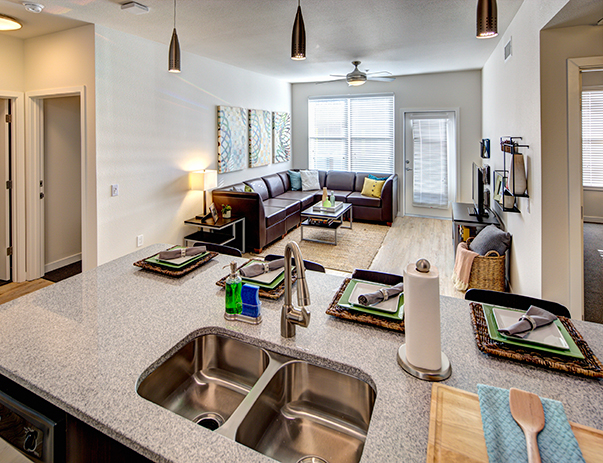 Fully equipped kitchens with granite countertops & stainless steel appliances that overlook the spacious living area