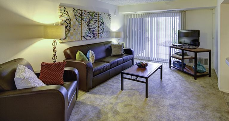 Fully furnished, spacious living room at Willowtree Apartments and Tower