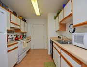 Fully equipped kitchen at College Club Townhomes
