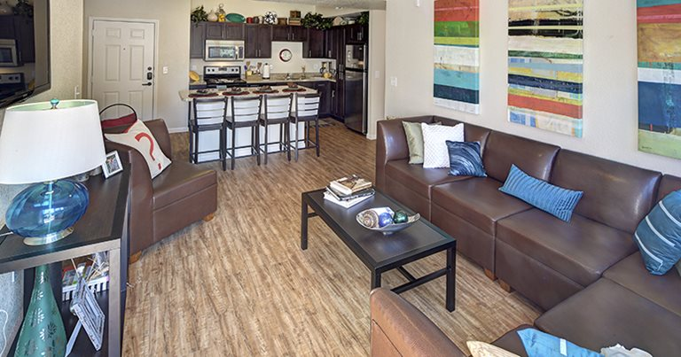 Fully furnished living room at Campus Edge on UTA Boulevard