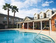 Swimming pool and sundeck at College Club Townhomes