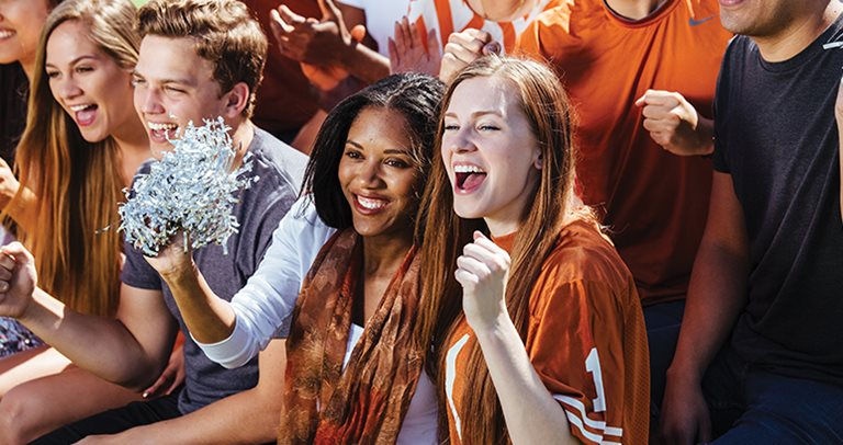 Excited students available  at Texan and Vintage West Campus near UT Austin cheering on the UT Longhorns