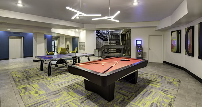 Recreation center with billiards and ping pong at The Tower at Third