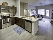 Fully equipped kitchens with quartz stone countertops & stainless steel appliances at U Pointe on Speight