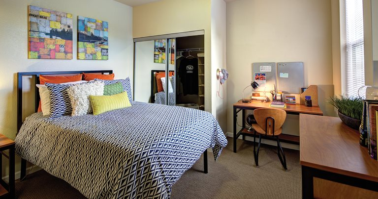 Fully furnished bedroom at Villas at Chestnut Ridge