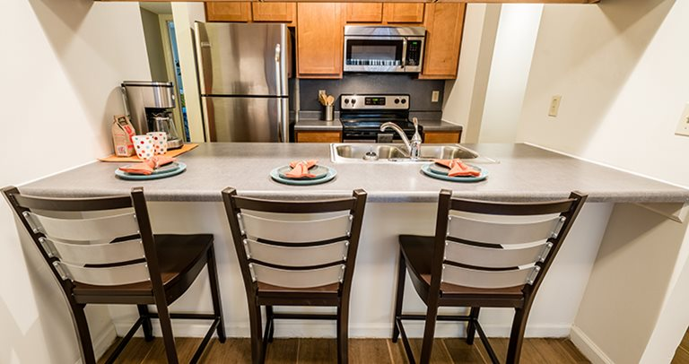 Fully equipped kitchen with stainless steel appliances at Camupstown Rentals